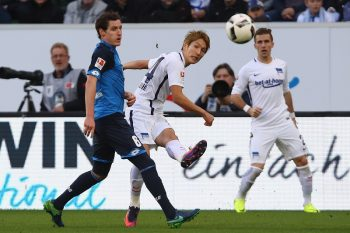 SINSHEIM, GERMANY - OCTOBER 30: Genki Haraguchi of Berlin is challenged by Sebastian Rudy of Hoffenheim during the Bundesliga match between TSG 1899 Hoffenheim and Hertha BSC at Wirsol Rhein-Neckar-Arena on October 30, 2016 in Sinsheim, Germany.  (Photo by Alex Grimm/Bongarts/Getty Images)