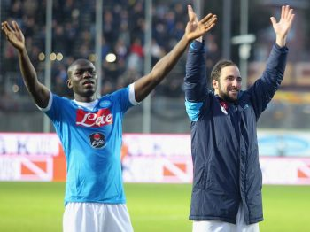 FROSINONE, ITALY - JANUARY 10:  Gonzalo Higuain (R) with his teammate Kalidou Koulibaly of SSC Napoli celebrates their victory after Serie A match between Frosinone Calcio and SSC Napoli at Stadio Matusa on January 10, 2016 in Frosinone, Italy.  (Photo by Paolo Bruno/Getty Images)
