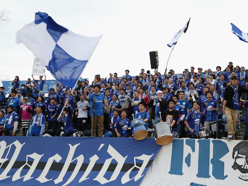 MACHIDA, JAPAN - APRIL 03:  (EDITORIAL USE ONLY) Machida Zelvia supporters cheer prior to the J.League second division match between Machida Zelvia and Consadole Sapporo at the Machida Stadium on April 3, 2016 in Machida, Tokyo, Japan.  (Photo by Kaz Photography/Getty Images)
