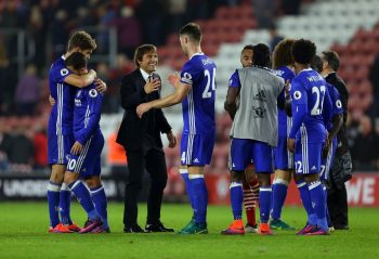 SOUTHAMPTON, ENGLAND - OCTOBER 30: A smiling Antonio Conte manager / head coach of Chelsea greets captain Gary Cahill of Chelsea as the rest of the team congratulate each other around him  the Premier League match between Southampton and Chelsea at St Mary's Stadium on October 30, 2016 in Southampton, England. (Photo by Catherine Ivill - AMA/Getty Images)