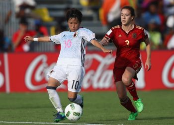 PORT MORESBY, PAPUA NEW GUINEA - NOVEMBER 16:  Beatriz Beltran Sanz of Spaintries to tackle Yuka Momiki of Japan during the FIFA U-20 Women's World Cup, Group B match between Spain and Japan at Bava Park on November 16, 2016 in Port Moresby, Papua New Guinea.  (Photo by Ian Walton - FIFA/FIFA via Getty Images)
