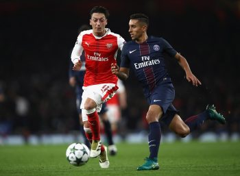 LONDON, ENGLAND - NOVEMBER 23: Marquinhos of PSG (R) is chased by Mesut Ozil of Arsenal (L) during the UEFA Champions League Group A match between Arsenal FC and Paris Saint-Germain at the Emirates Stadium on November 23, 2016 in London, England.  (Photo by Julian Finney/Getty Images)