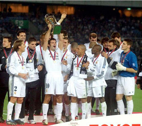 Luis Figo of Real Madrid lifts the trophy