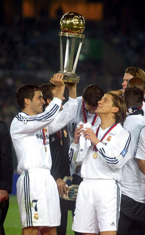 Raul of Real Madrid lifts the trophy