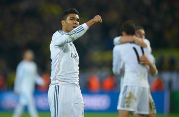 DORTMUND, GERMANY - APRIL 08: Casemiro of Real Madrid celebrates after the UEFA Champions League Quarter Final second leg match between Borussia Dortmund and Real Madrid at Signal Iduna Park on April 8, 2014 in Dortmund, Germany.  (Photo by Dennis Grombkowski/Bongarts/Getty Images)