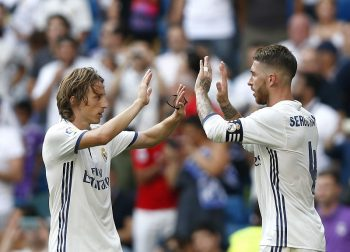 MADRID, SPAIN - SEPTEMBER 10: Sergio Ramos (R) of Real Madrid celebrates with his teammate Luka Modric after scoring his team's third goal during the La Liga match between Real Madrid CF and CA Osasuna at Estadio Santiago Bernabeu on September 10, 2016 in Madrid, Spain.  (Photo by Victor Carretero/Real Madrid via Getty Images)