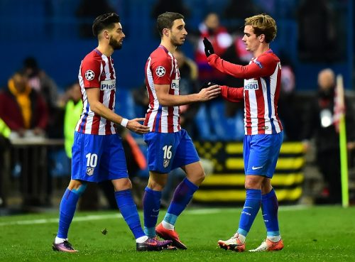 MADRID, SPAIN - NOVEMBER 23:  Antoine Griezmann of Atletico Madrid celebrates with team-mates Sime Vrsaljko and Yannick Carrasco (L) at the end of the UEFA Champions League match between Club Atletico de Madrid and PSV Eindhoven at Vicente Calderon Stadium on November 23, 2016 in Madrid, Spain.  (Photo by Richard Martin-Roberts - AMA/Getty Images)