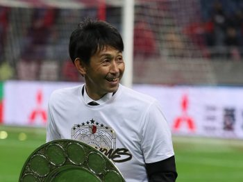 SAITAMA, JAPAN - DECEMBER 03: (EDITORIAL USE ONLY) Masatada Ishii the head coach / manager of Kashima Antlers with the J-League shield trophy after victory in the J.League Championship Final second leg match between Urawa Red Diamonds and Kashima Antlers at Saitama Stadium on December 3, 2016 in Saitama, Japan. (Photo by Matthew Ashton - AMA/Getty Images)