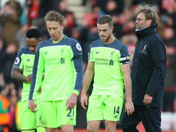 BOURNEMOUTH, ENGLAND - DECEMBER 04: Jurgen Klopp manager / head coach of Liverpool walks behind a dejected looking Jordan Henderson, Lucas Leiva  and Nathaniel Clyne of Liverpool during the Premier League match between AFC Bournemouth and Liverpool at Vitality Stadium on December 4, 2016 in Bournemouth, England. (Photo by Catherine Ivill - AMA/Getty Images)