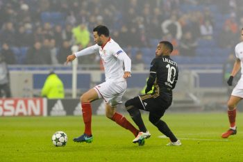 Adil Rami of Sevilla and Alexandre Lacazette of Lyon during the Champions League match between Lyon and Sevilla at Stade des Lumieres on December 7, 2016 in Decines-Charpieu, France. (Photo by Jean Paul Thomas/Icon Sport) (Photo by Jean Paul Thomas/Icon Sport via Getty Images)