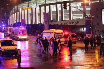 Turkish emergency workers and police officers are seen on the site where a car bomb exploded near the stadium of football club Besiktas in central Istanbul on December 10, 2016. The car bomb exploded in the heart of Istanbul on late December 10, wounding around 20 police officers, Turkey's interior minister said, quoted by the official Anadolu news agency. The bomb, apparently targeting a bus carrying police officers, exploded outside the stadium of Istanbul football club Besiktas following its match against Bursaspor. (Photo by Emrah Oprukcu/NurPhoto via Getty Images)