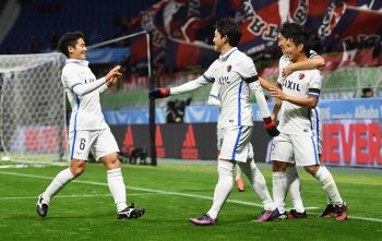 SUITA, JAPAN - DECEMBER 11:  Yasushi Endo (R) of Kashima Antlers celebrates scoring the opening goal with team mates during the FIFA Club World Cup second round match between Mamelodi Sundowns and Kashima Antlers at Suita City Football Stadium on December 11, 2016 in Suita, Japan.  (Photo by Shaun Botterill - FIFA/FIFA via Getty Images)