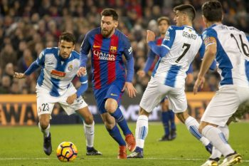 BARCELONA, SPAIN - DECEMBER 18: Leo Messi (L 2) of Barcelona in action during the La Liga soccer match between FC Barcelona and RCD Espanyol at Camp Nou Stadium in Barcelona, Spain on December 18, 2016. (Photo by Albert Llop/Anadolu Agency/Getty Images)