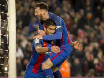 BARCELONA, SPAIN - DECEMBER 18: Luis Suarez and Leo Messi of Barcelona celebrate scoring a goal during the La Liga soccer match between FC Barcelona and RCD Espanyol at Camp Nou Stadium in Barcelona, Spain on December 18, 2016. (Photo by Albert Llop/Anadolu Agency/Getty Images)
