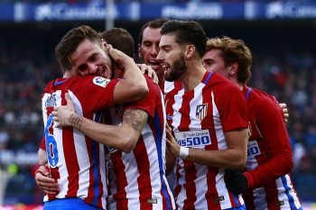 MADRID, SPAIN - DECEMBER 17: Saul Niguez (2ndL)  of Atletico de Madrid celebrates scoring their opening goal with teammates Koke (L), Gabi Fernandez (3dL), Diego Godin (3dR), Yannick Carrasco (3dR), Diego Godin (2ndR) and Antoine Griezmann (R) during the La Liga match between Club Atletico de Madrid and UD Las Palmas at Vicente Calderon Stadium on December 17, 2016 in Madrid, Spain. (Photo by Gonzalo Arroyo Moreno/Getty Images)