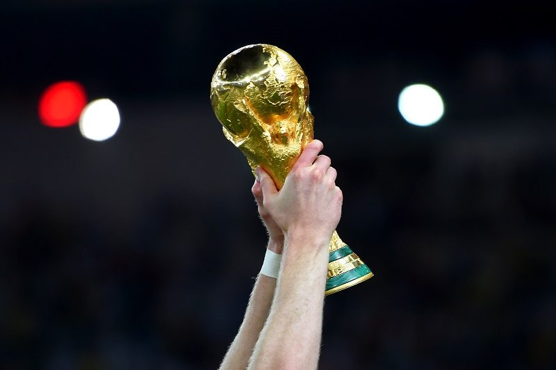 RIO DE JANEIRO, BRAZIL - JULY 13:  Andre Schuerrle of Germany holds up the World Cup trophy after the 2014 FIFA World Cup Brazil Final match between Germany and Argentina at Maracana on July 13, 2014 in Rio de Janeiro, Brazil.  (Photo by Mike Hewitt - FIFA/FIFA via Getty Images)