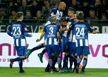 DORTMUND, GERMANY - OCTOBER 14:  Valentin Stocker #14 of Berlin celebrate with his team mates after he scores the opening goal during the Bundesliga match between Borussia Dortmund and Hertha BSC at Signal Iduna Park on October 14, 2016 in Dortmund, Germany.  (Photo by Lars Baron/Bongarts/Getty Images)