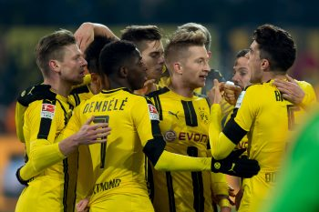 DORTMUND, GERMANY - DECEMBER 03: Players of Dortmund celebrate a goal  during the Bundesliga match between Borussia Dortmund and Borussia Moenchengladbach at Signal Iduna Park on December 3, 2016 in Dortmund, Germany. (Photo by TF-Images/Getty Images)