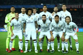 YOKOHAMA, JAPAN - DECEMBER 18:  The Real Madrid team line up prior to kick off during the FIFA Club World Cup Final match between Real Madrid and Kashima Antlers at International Stadium Yokohama on December 18, 2016 in Yokohama, Japan.  (Photo by Steve Bardens-FIFA/FIFA via Getty Images)