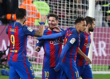 Luis Suarez (L) and Lionel Messi (C) of Barcelona celebrates with his teammates after scoring the first goal during the La Liga match between FC Barcelona and RCD Espanyol at Camp Nou Stadium on December 18, 2016 in Barcelona, Spain. (Photo by Ahmad Mora/NurPhoto via Getty Images)