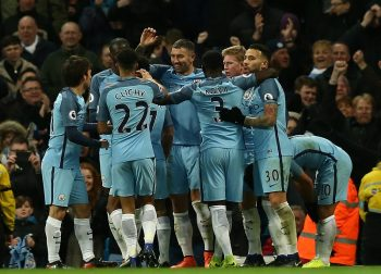 MANCHESTER, ENGLAND - JANUARY 02: Manchester City players celebrate the goal scored by Sergio Aguero during the Premier League match between Manchester City and Burnley at Etihad Stadium on January 2, 2017 in Manchester, England.  (Photo by Jan Kruger/Getty Images)