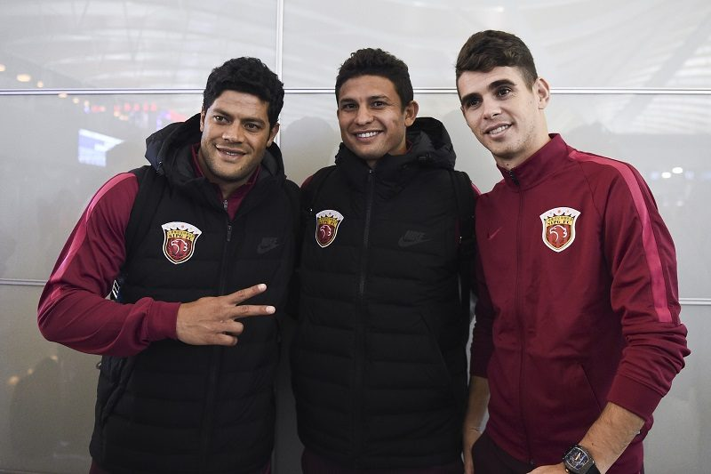 SHANGHAI, CHINA - JANUARY 03:  (L - R) Hulk, Elkeson and Oscar of Shanghai SIPG pose for photos at Pudong International Airport prior to their team's departure to the Doha training camp on January 3, 2017 in Shanghai, China.  (Photo by VCG/VCG via Getty Images)