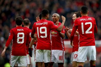 MANCHESTER, ENGLAND - JANUARY 07: Marcus Rashford of Manchester United celebrates with team mates after scoring his first and his sides fourth during the Emirates FA Cup third round match between Manchester United and Reading at Old Trafford on January 7, 2017 in Manchester, England.  (Photo by Clive Brunskill/Getty Images)