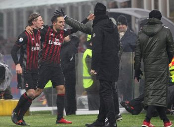 MILAN, ITALY - JANUARY 12:  Giacomo Bonaventura (2nd L) of AC Milan celebrates his goal with his team-mate Ignazio Abate (L) during the TIM Cup match between AC Milan and AC Torino at Giuseppe Meazza Stadium on January 12, 2017 in Milan, Italy.  (Photo by Marco Luzzani/Getty Images)