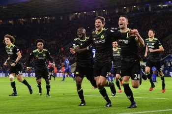 LEICESTER, ENGLAND - JANUARY 14:  Marcos Alonso (C) of Chelsea celebrates with teammates Victor Moses (L) and Gary Cahill (R) after scoring his team's second goal during the Premier League match between Leicester City and Chelsea at The King Power Stadium on January 14, 2017 in Leicester, England.  (Photo by Darren Walsh/Chelsea FC via Getty Images)