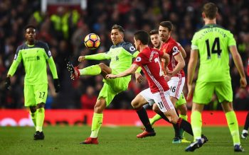 MANCHESTER, ENGLAND - JANUARY 15:  Roberto Firmino of Liverpool controls the ball from Ander Herrera of Manchester United during the Premier League match between Manchester United and Liverpool at Old Trafford on January 15, 2017 in Manchester, England.  (Photo by Laurence Griffiths/Getty Images)