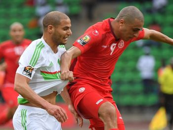 FRANCEVILLE, GABON - JANUARY 19: Tunisia's Ahmed Akaichi (R) in action during the African Cup of Nations Group B soccer match between Algeria and Tunisia at the Stade de Franceville on January 19, 2017 in Franceville, Gabon. (Photo by Chris Nail/Anadolu Agency/Getty Images)
