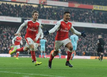 LONDON, ENGLAND - JANUARY 22:  (R) Alexis Sanchez celebrstes scoring the 2nd Arsenal goal with (L) Nacoh Monreal during the Premier League match between Arsenal and Burnley at Emirates Stadium on January 22, 2017 in London, England.  (Photo by Stuart MacFarlane/Arsenal FC via Getty Images)